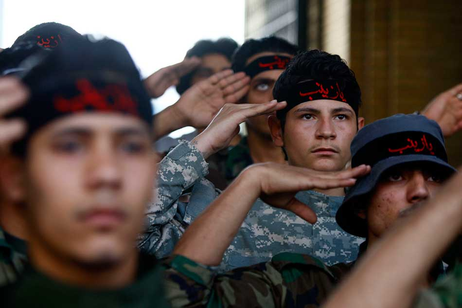 Shia fighters stationed in Damascus to protect Prophet Muhammad (PHUB) granddaughter's shrine. PHOTO REUTERS
