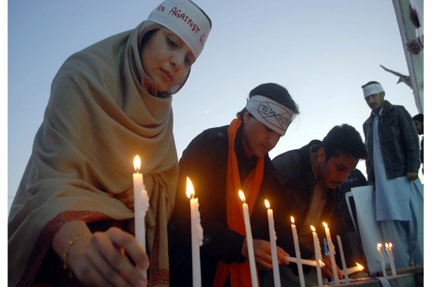 Members of Civil Society are enlightening candles in commemoration of martyrs of APS. PHOTO: PPI