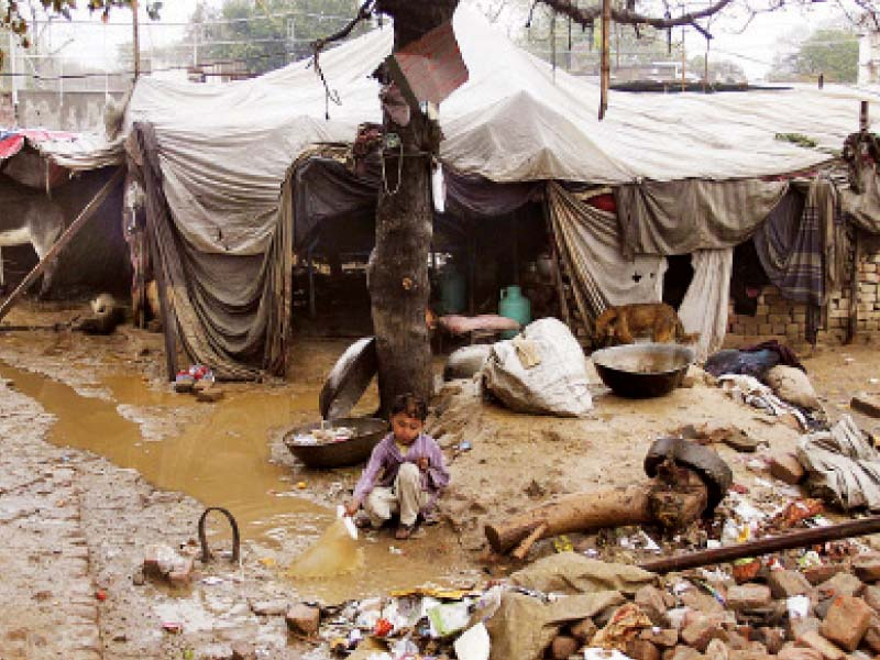 This katchi abadi in Dharampura shows the poor living conditions in which 55 per cent of the city's population resides. Developers want to provide the residents of these slum areas low-cost housing. PHOTO: FILE