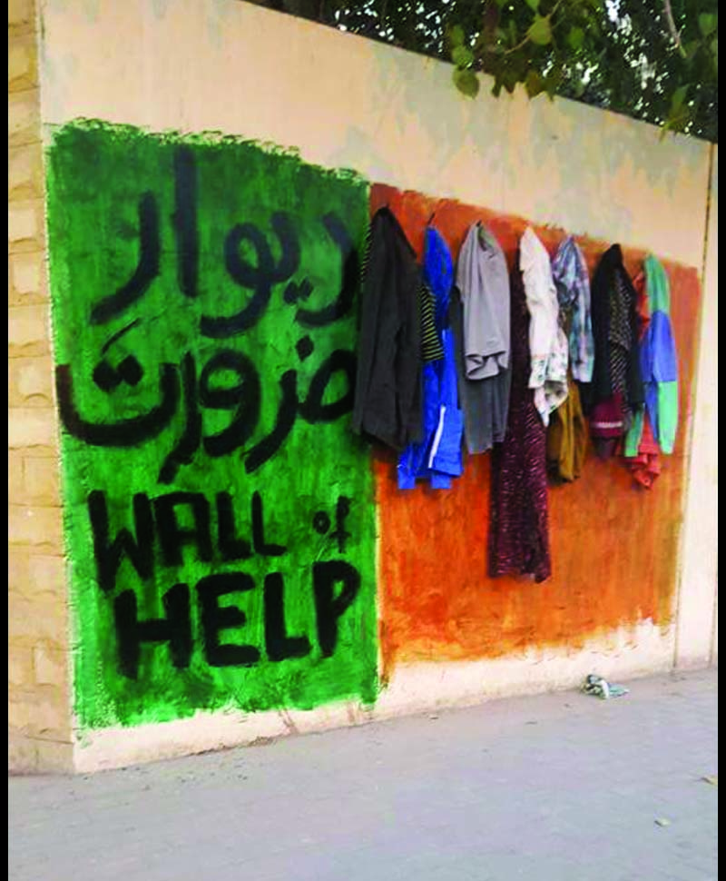 A 'Wall of Help' initiative was taken up by students after watching videos of similar initiatives in Peshawar and DHA, Karachi. PHOTOS: COURTESY IMDAD ALI, AYESHA MIR/EXPRESS