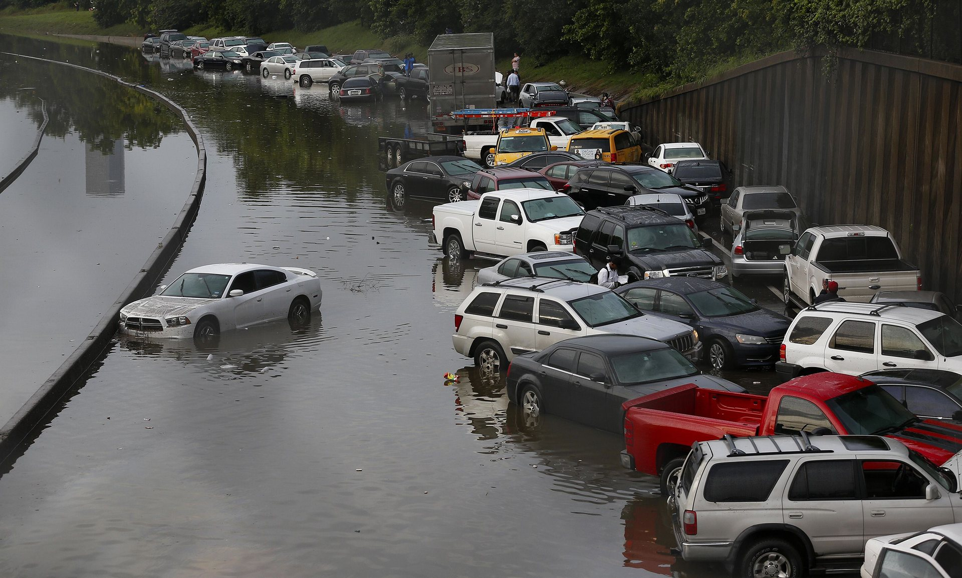 Vehicles left stranded on a flooded Interstate 45 in Houston, Texas. PHOTO: AFP