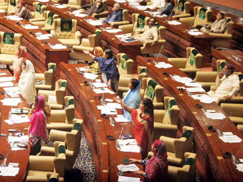 Female lawmakers of the Pakistan Peoples Party protest the behaviour of opposition members, who walked out of the session on Friday after an argument with parliamentary affairs minister Nisar Ahmed Khuhro. PHOTO: ONLINE