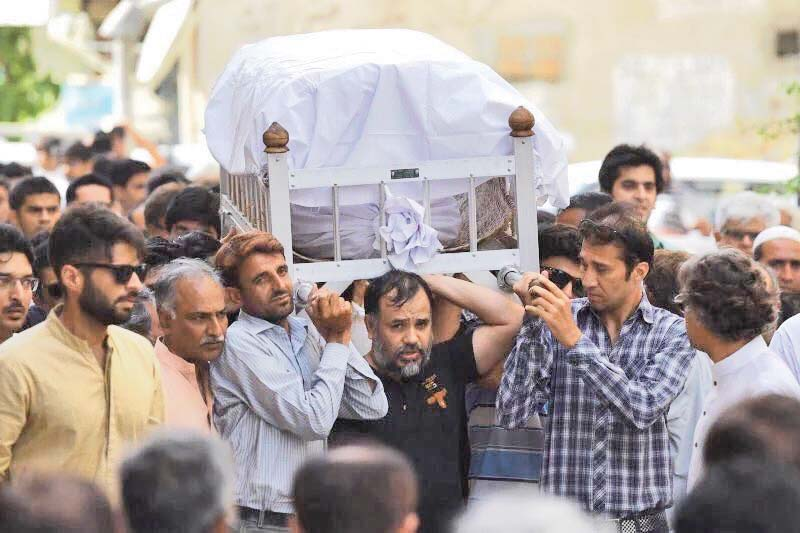 Slain activist Khurram Zaki shoulders the coffin of Sabeen Mahmud, the director of T2F, after she was gunned down by armed assailants last year. PHOTO: COURTESY SOCIAL MEDIA