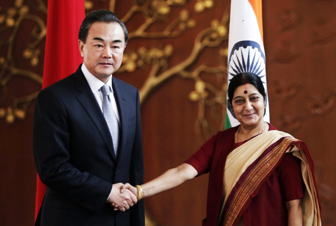 Chinese Foreign Minister Wang Yei with Indian counter part Sushma Swaraj. PHOTO: REUTERS