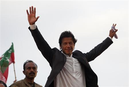 Imran Khan waves to his supporters. PHOTO: REUTERS