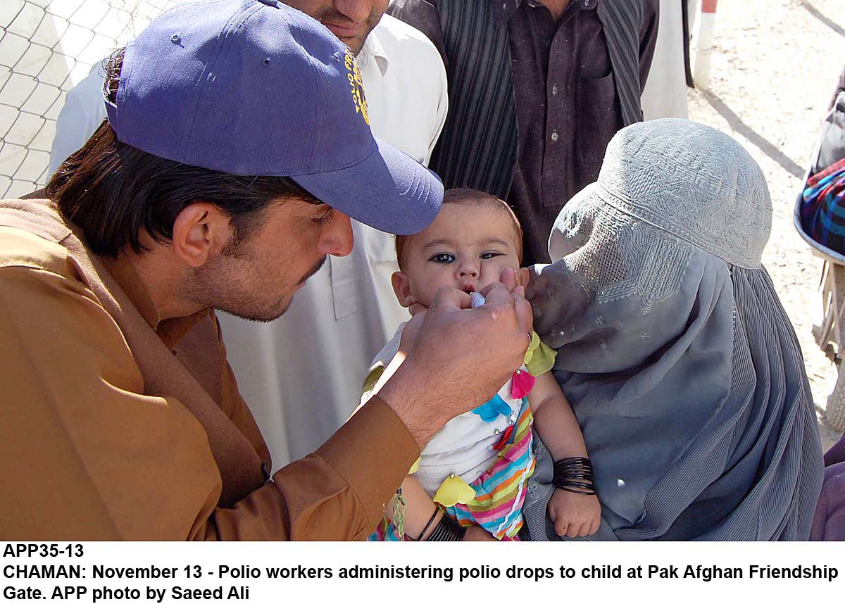 A file photo of a helath worker vaccinating a child. PHOTO: APP