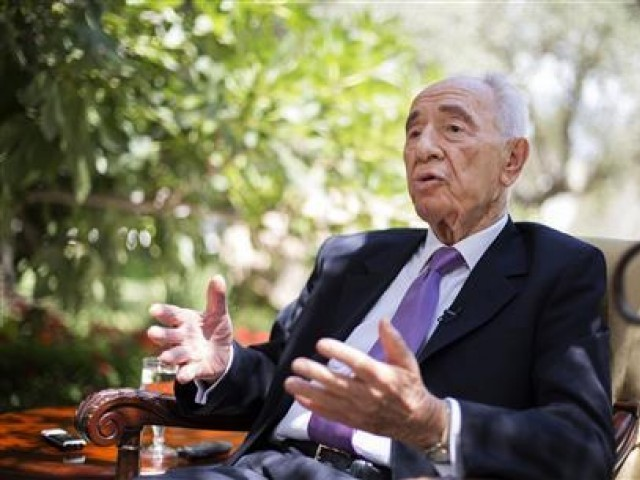 Israel's President Shimon Peres speaks during an interview with Reuters at his residence in Jerusalem June 16, 2013. PHOTO: REUTERS