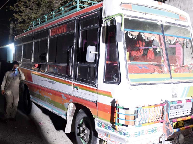 A man walks beside the bus that was targeted by armed gunmen. PHOTO: INP