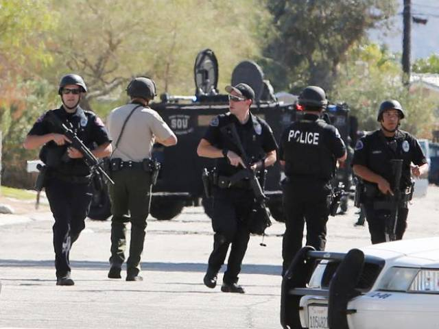 Armed police officers are shown during a standoff where three officers were shot by a suspect in Palm Springs, California, US October 8, 2016. PHOTO: REUTERS