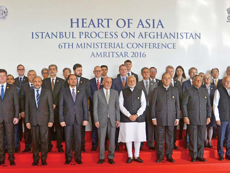 Modi and Ghani line up with other delegates at the Heart of Asia Conference. PHOTO: AFP