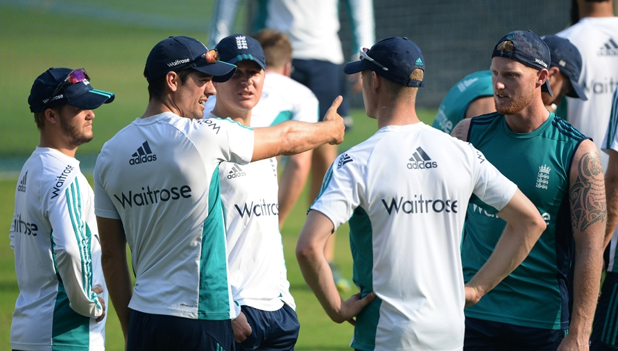 England's Ben Duckett (L), Gareth Batty (3L), Keaton Jennings (2R) and Ben Stokes (R) listen as captain Alastair Cook (2L) speaks during a training session at the Wankhede stadium ahead of the fourth test cricket match between India and England in Mumbai on December 6, 2016. PHOTO: AFP