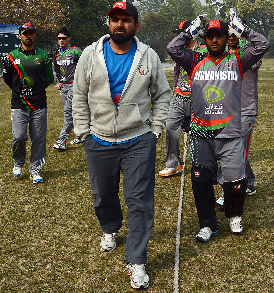 Kabir Khan (C) while coaching Afghanistan players in Lahore on January 31, 2013. PHOTO: AFP
