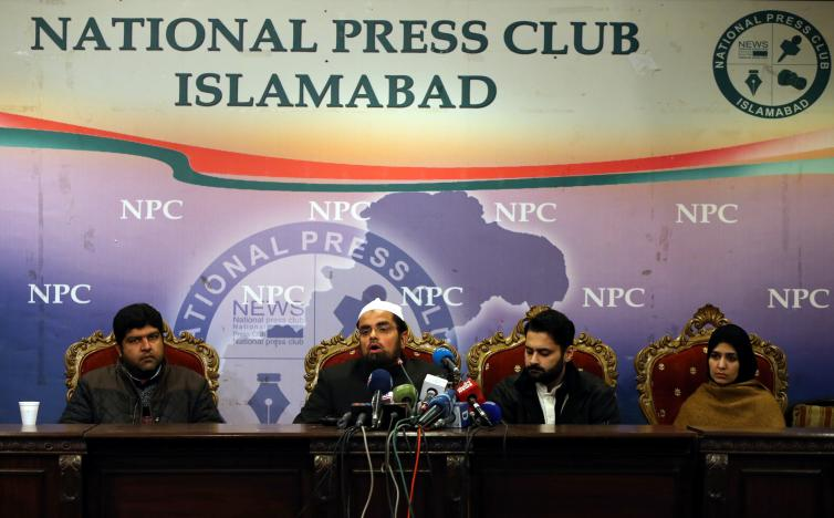 Mufti Faisal Khushi speaks as Mesha Saeed (R), wife of missing social activist Waqass Goraya, Jibran Nasir (2ndR) a human rights lawyer and Faraz Haider (L), brother of missing social activist Salman Haider, listen during a news conference in Islamabad, Pakistan January 18, 2017. PHOTO: REUTERS