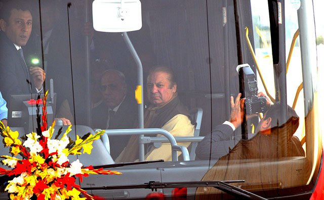 Prime Minister Nawaz Sharif travels in a Metro Bus after inauguration of the service in Multan. PHOTO: APP