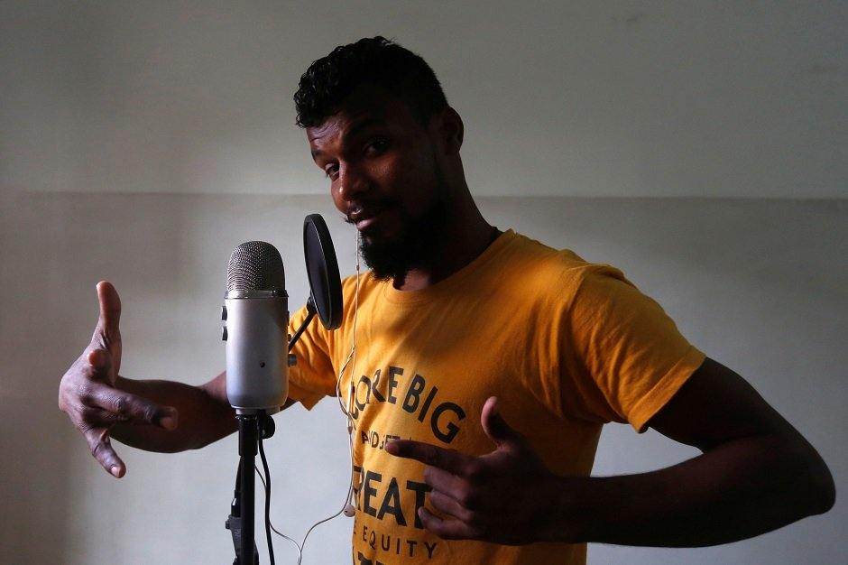 Lyari UnderGround (L.U.G) rapper, Slipknot Denna, poses for a camera during an interview with Reuters in Karachi. PHOTO: REUTERS