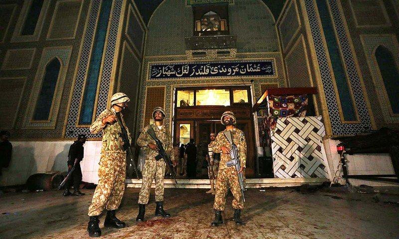 Soldiers stand guard outside Lal Shahbaz Qalandar's shrine. PHOTO: APP