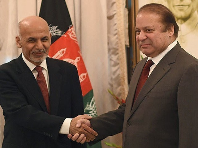 In this file photo, Afghan President Ashraf Ghani shakes hands with Prime Minister Nawaz Sharif. PHOTO: AFP