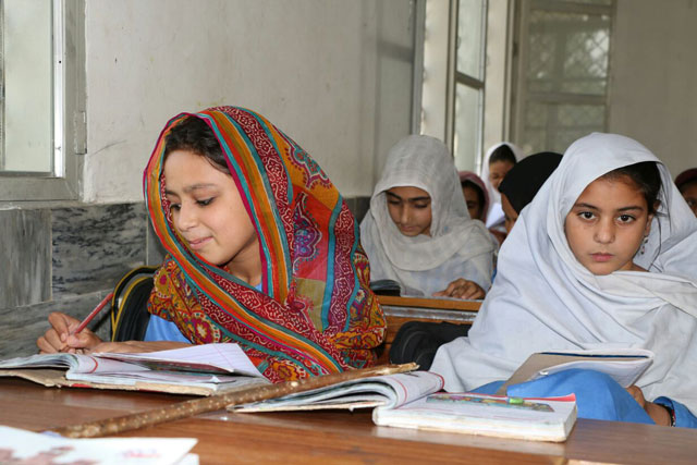 Students are seen attending their classes  in a recently reconstructed school in Khyber-Pakhtunkhwa's Malakand Division. PHOTO: EXPRESS