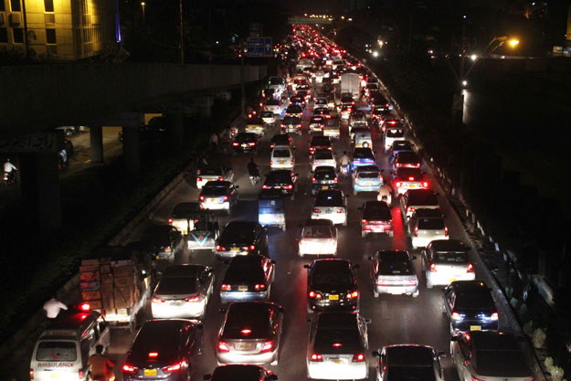 Traffic gridlock on Shahrah-e-Faisal, Karachi. PHOTO: EXPRESS