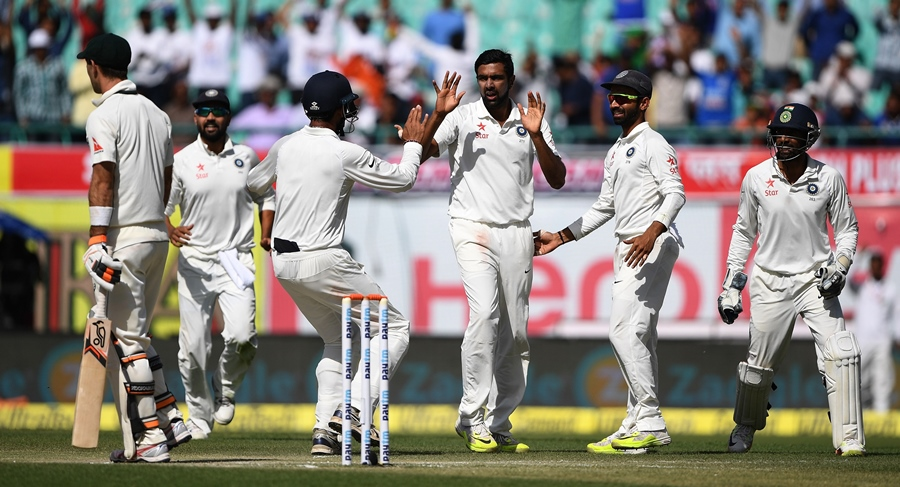 India's Ravichandran Ashwin (C) celebrates with teammates after taking the wicket of Australia's Glenn Maxwell (L) during the third day of the fourth and last Test cricket match between India and Australia at The Himachal Pradesh Cricket Association Stadium in Dharamsala on March 27, 2017. PHOTO: AFP