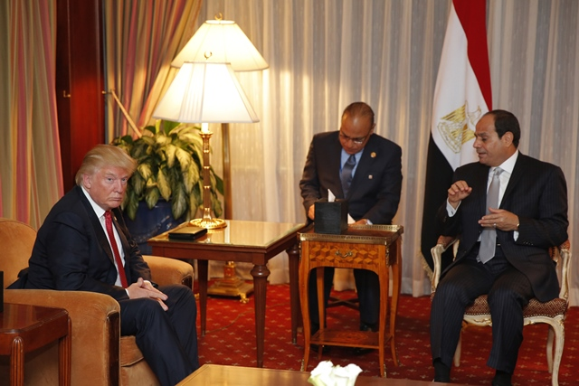 Donald Trump (L) looking on as Egyptian President Abdel Fattah el-Sisi speaks during a meeting at the Plaza Hotel in New York. PHOTO: AFP