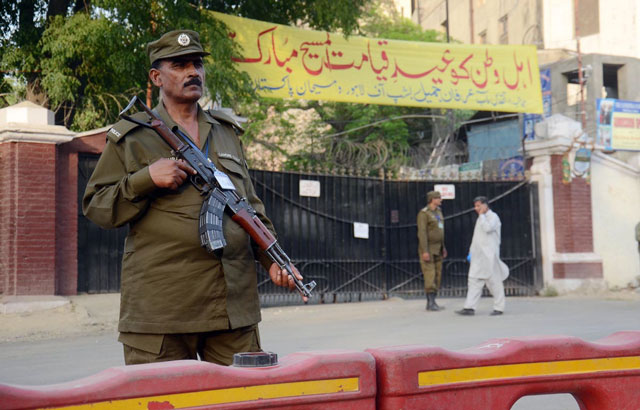 Policemen stand guard outside a local church in Lahore on Saturday, April 15, 2017. PHOTO: ONLINE