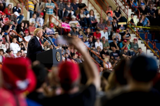 US President Donald Trump addresses a 'Make America Great Again' rally in Harrisburg, PA, April 29, 2017, marking his 100th day in office. PHOTO: AFP