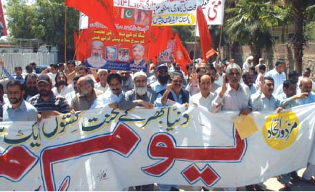 Workers and activists participate in a Labour Day rally. PHOTO: ZAFAR ASLAM/EXPRESS