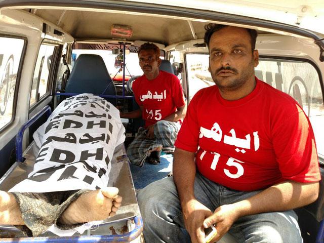 Body of a teenager who drowned off Sandspit beach near Hawksbay is seen inside an Edhi ambulance in Karachi on Tuesday, May 23, 2017. PHOTO: FARAZ KHAN