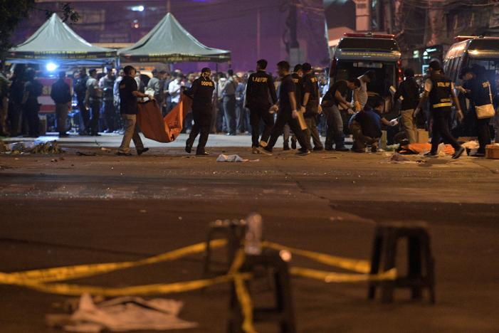 Police investigate the scene of an explosion at a bus station in Kampung Melayu, East Jakarta, Indonesia. PHOTO: REUTERS