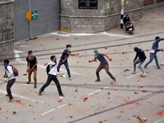 Demonstrators throw stones towards the Indian police during a protest in Srinagar, May 9, 2017. PHOTO: REUTERS