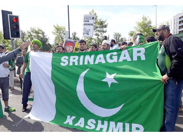 Kashmiri protesters holding Pakistani flag stage a demonstration outside the Edgbaston Cricket Ground against Indian atrocities in the held territory on June 4, 2017. PHOTO: NNI