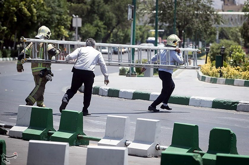 Members of Iranian civil defence run during an attack on the Iranian parliament in central Tehran, Iran, June 7, 2017. PHOTO: REUTERS