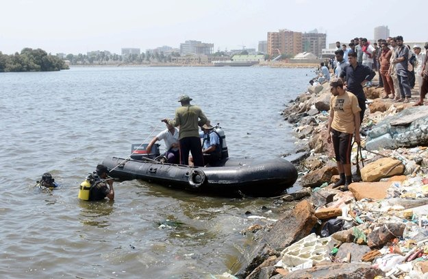 Rescuers search for the bodies of two teenagers in the waters of Mai Kolachi Creek in Karachi on Sunday, June 11, 2017. PHOTO: NNI