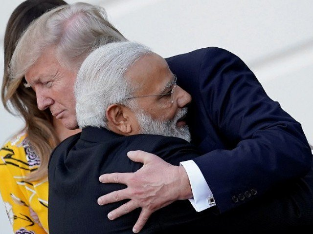 India's Prime Minister Narendra Modi hugs US President Donald Trump as he departures the White House after a visit, in Washington, US. PHOTO: REUTERS