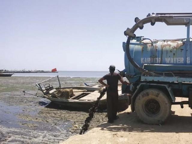 Karachi Water and Sewerage Board releasing waste into sea. PHOTO: FILE