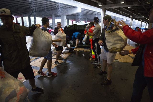 Volunteers unload donated items at the George Brown Convention Center which has been turned into a shelter run by the American Red Cross to house victims of the high water from Hurricane Harvey on August 28, 2017 in Houston, Texas. PHOTO: AFP