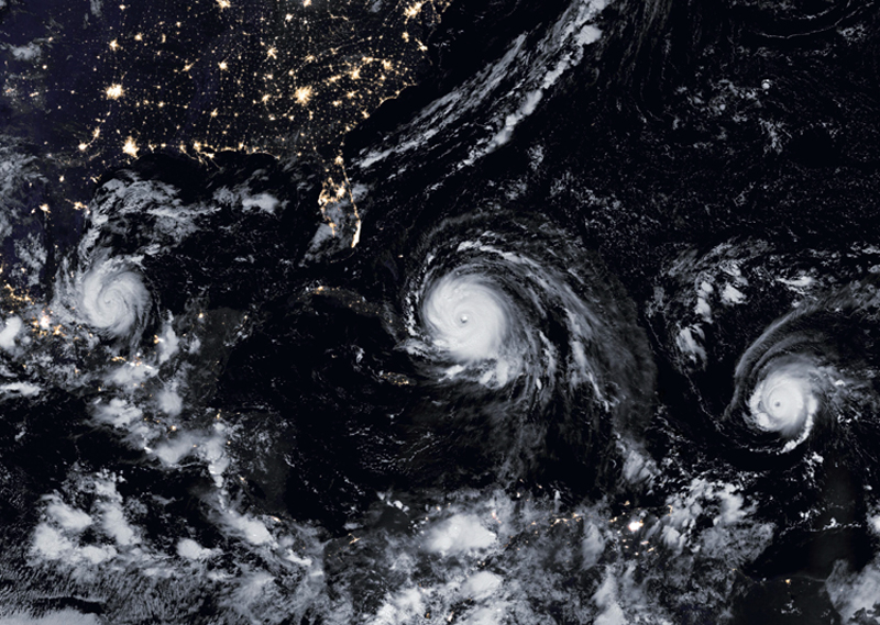 This satellite image obtained from NASA's Earth Obervatory on Septermber 8, 2017 shows Hurricane Irma (C), Hurricane Jose (R), and Hurricane Katia.  PHOTO: AFP