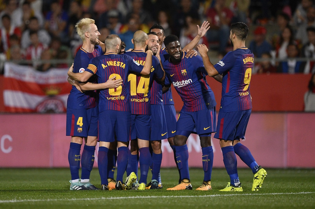 Easy does it: Barcelona were rarely troubled in 3-0 win over fellow Catalan side Girona. PHOTO: AFP