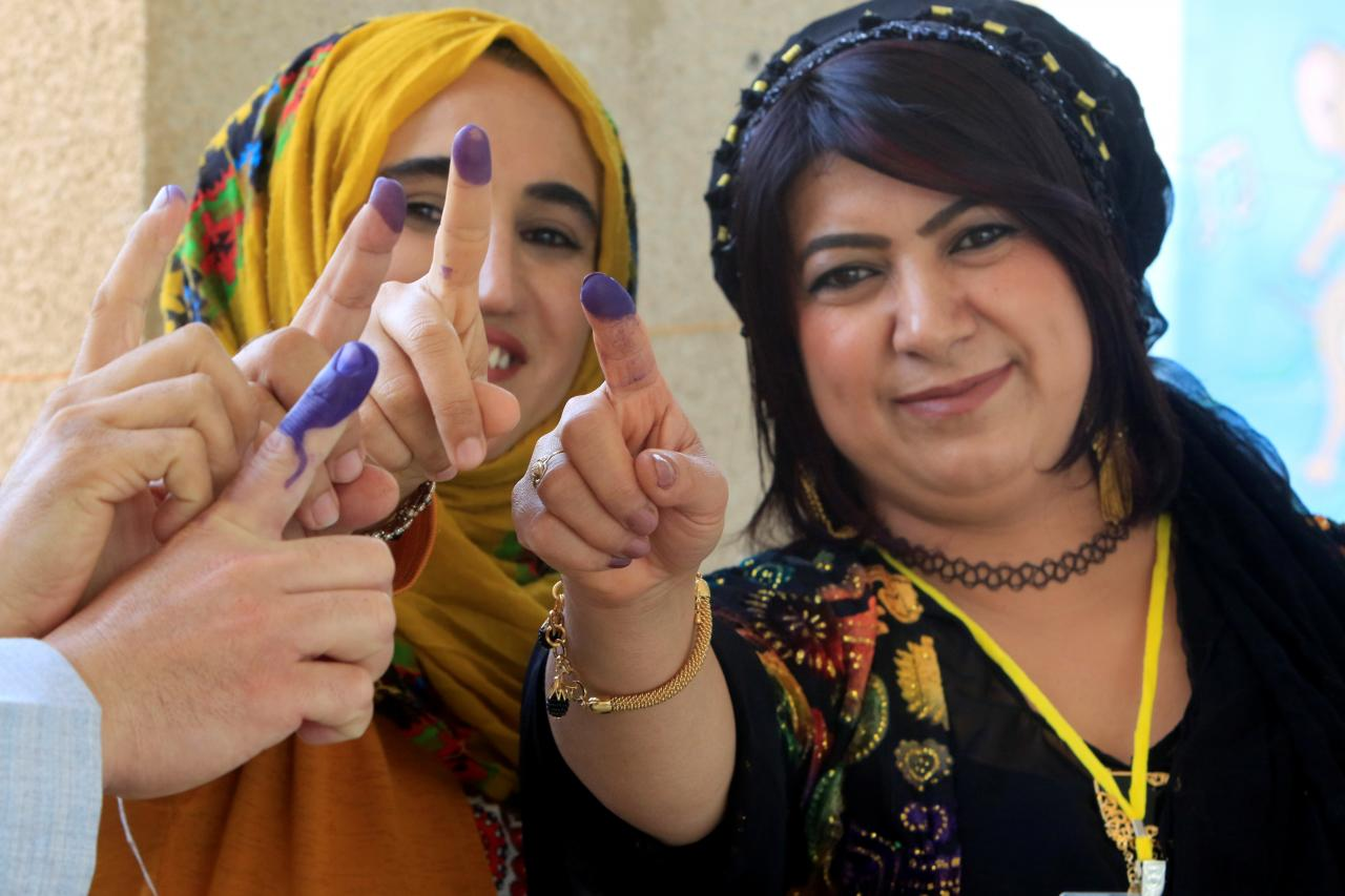 Employees show their ink-stained fingers during the Kurd independence referendum in Halabja, Iraq. PHOTO: REUTERS