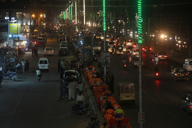 Encroachments appeared on University Road weeks after its inauguration. PHOTO: ATHAR KHAN