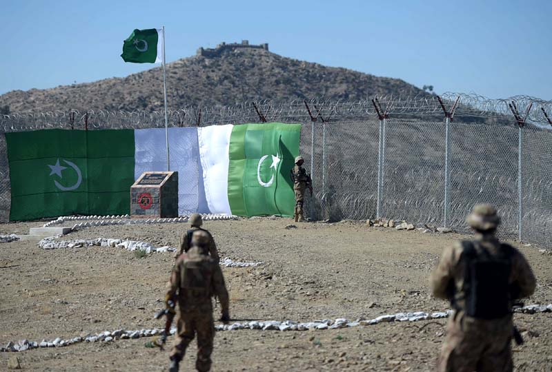 Sealing frontier: A Pakistani soldier keeps vigil at the border fencing along with Afghanistan's Paktika province in Angoor Adda, South Waziristan agency. PHOTO:AFP