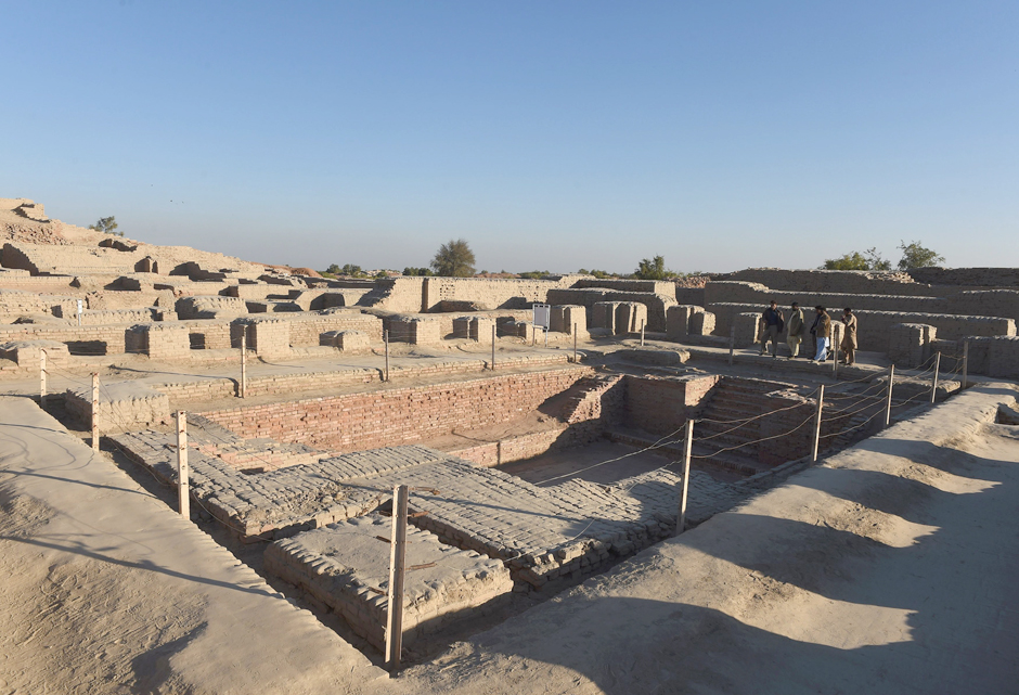 In this photograph taken on February 9, 2017, visitors walk through the UNESCO World Heritage archeological site of Mohenjo Daro some 425 kms north of the Pakistani city of Karachi. Once the centre of a powerful civilisation, Mohenjo Daro was one of the world's earliest cities -- a Bronze Age metropolis boasting flush toilets and a water and waste system to rival modern standards. Some 5,000 years on archaeologists believe the ruins could unlock the secrets of the Indus Valley people, who flourished around 3,000 BC in what is now India and Pakistan before mysteriously disappearing.PHOTO: AFP