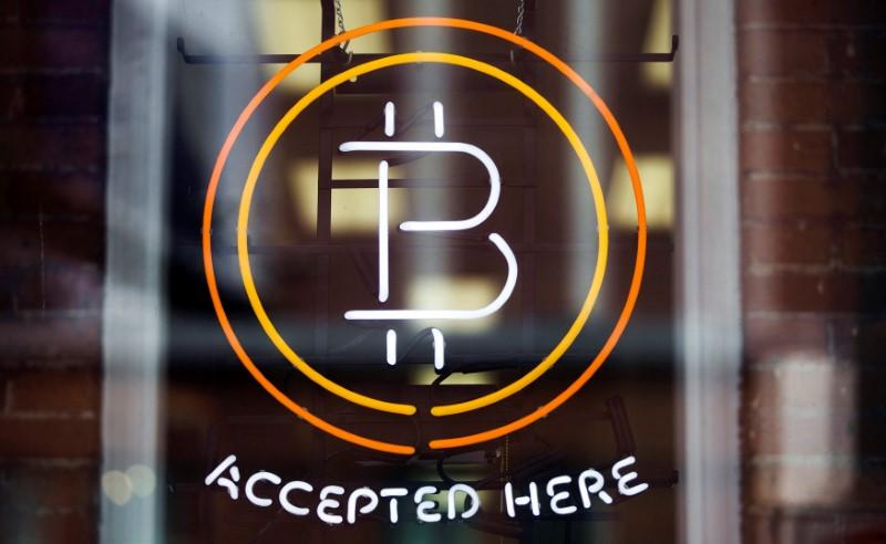 A Bitcoin sign is seen in a window in Toronto, Canada, May 8, 2014.      PHOTO: REUTERS