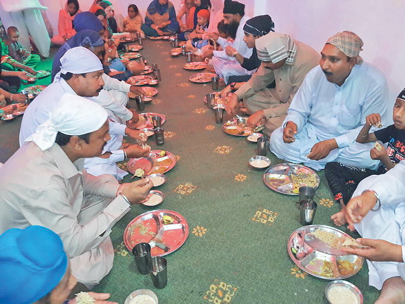 Sikh devotees mark the 549th birthday of Guru Nanak in Peshawar. PHOTOs: EXPRESS