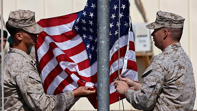 American soldiers raise the US flag. PHOTO: REUTERS