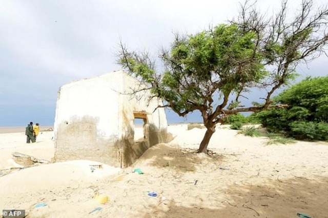 This file photo taken on October 26, 2015 near Saint-Louis du Senegal shows the remains of a house of the Doune Baba Dieye village which was abandoned because of the approaching sea. PHOTO: AFP