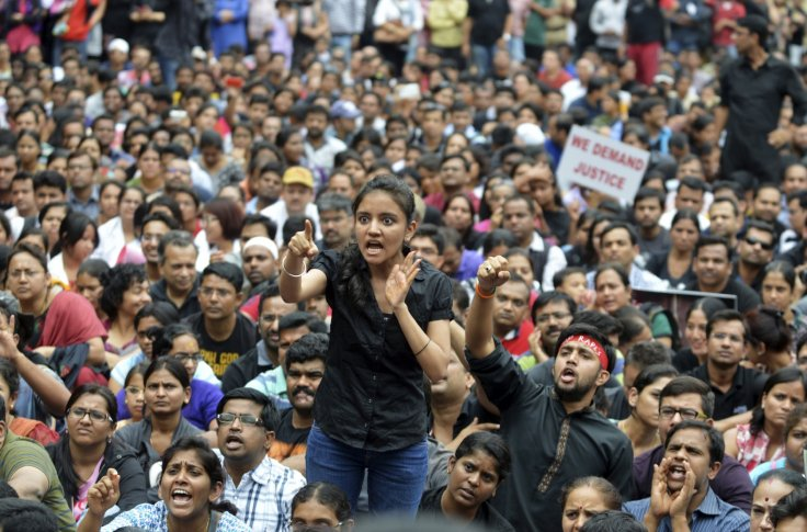 A number of Indians can be seen protesting violence against women.  PHOTO: REUTERS