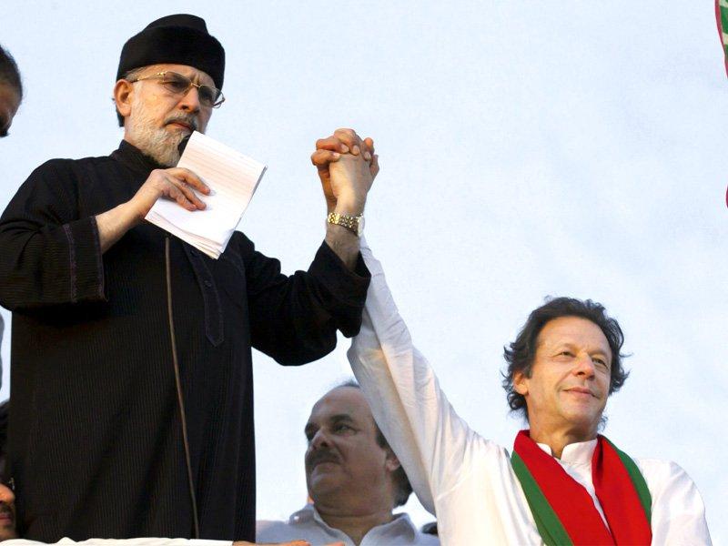 Tahirul Qadri and Imran Khan. PHOTO: AFP