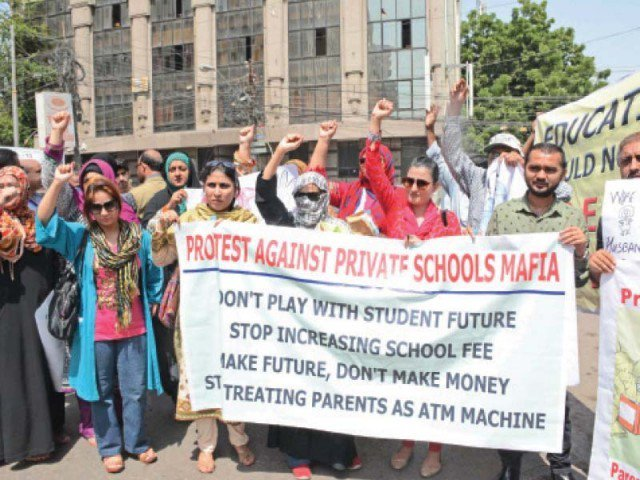 A protest outside Karachi Press Club where parents and other individuals spoke out against the raising of school fees in private schools on September 17, 2015. PHOTO: ONLINE